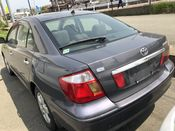back photo of car ZZT240 - 2003 Toyota PREMIO A18 G PACKAGE LTD - GREY