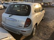 back photo of car M110A - 2000 Toyota DUET  - WHITE